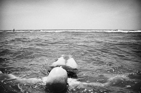 Jen floating in the ocean